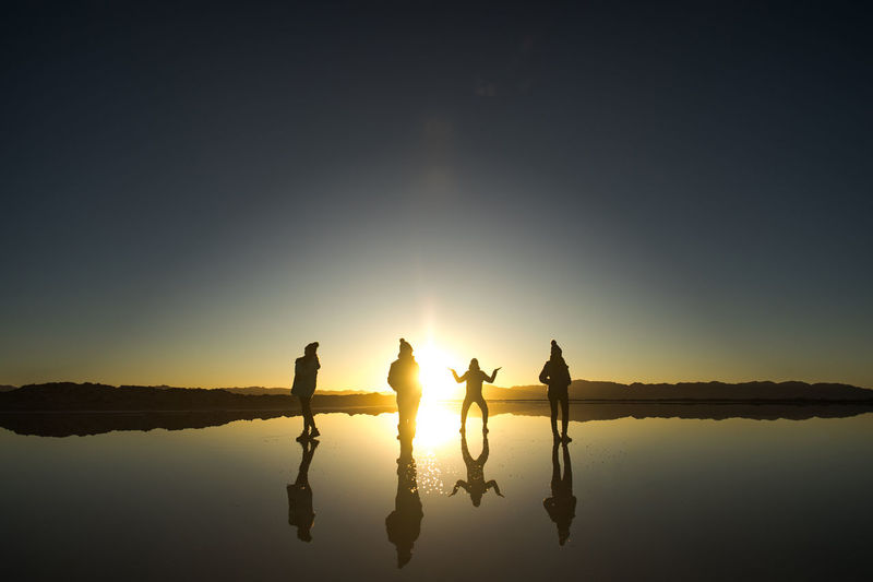 Water Reflection Sky Silhouette Lake Beauty In Nature Sunset Nature Sun Togetherness Tranquility Scenics - Nature Tranquil Scene Lifestyles Friendship Sunlight Group Of People Real People Standing Outdoors Lens Flare My Best Photo