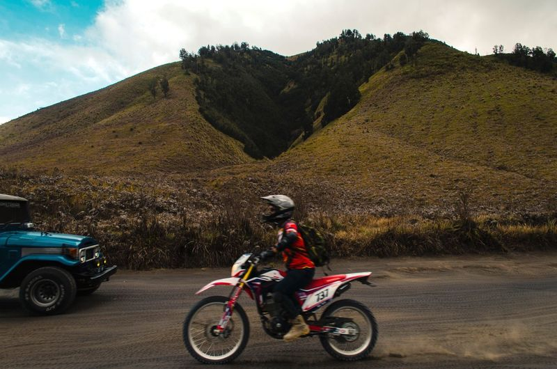 Travel Destinations Bromo Tengger Semeru National Park Amazing Scenery Bromo-tengger-semeru National Park Teletubbies Hills EyeEm Selects Mode Of Transportation Transportation Land Vehicle Real People One Person Sky Cloud - Sky Lifestyles Riding Men Motorcycle Nature Road Full Length Leisure Activity Outdoors Ride Helmet Day Headwear
