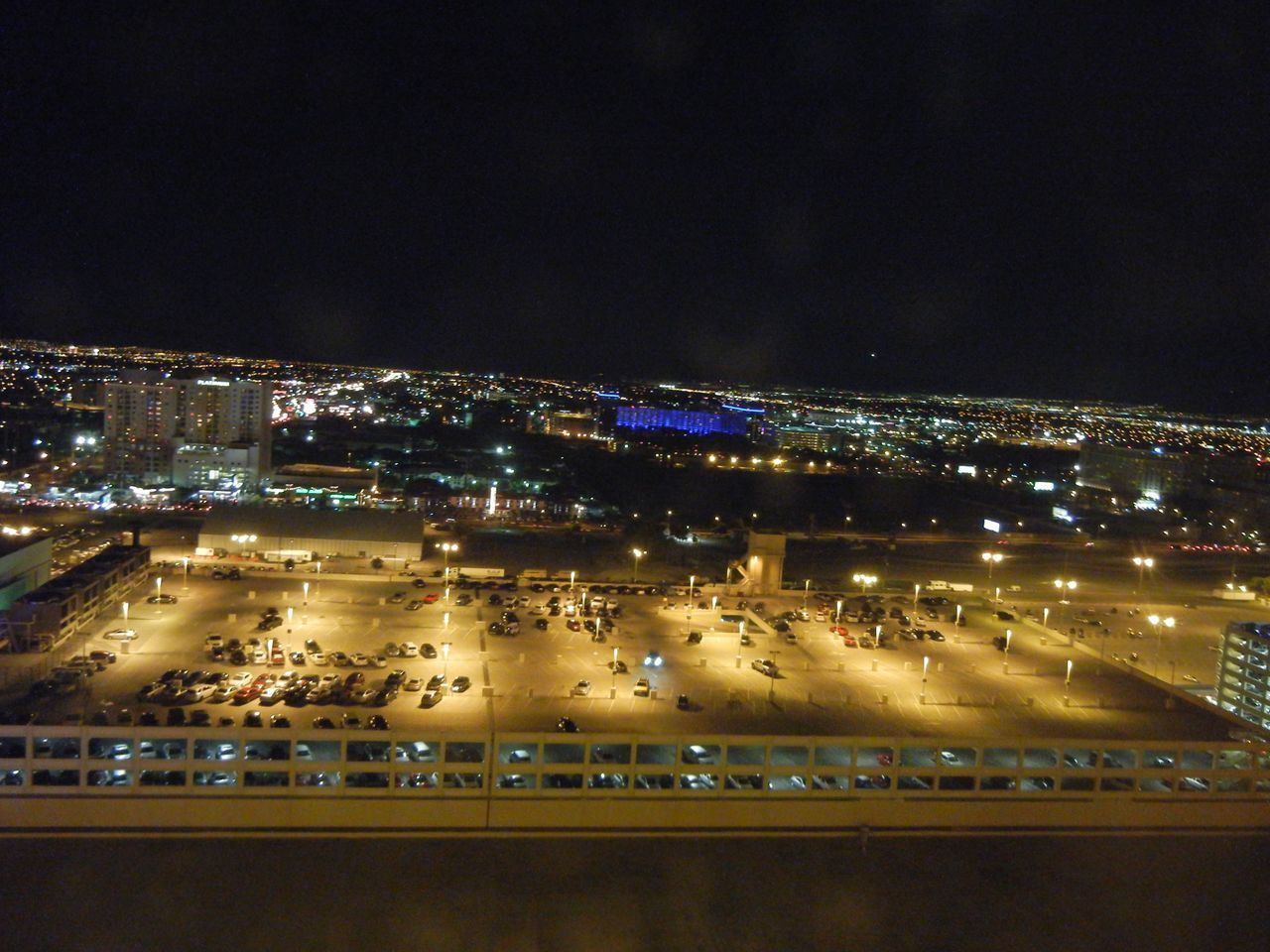 HIGH ANGLE VIEW OF ILLUMINATED BUILDINGS AGAINST SKY