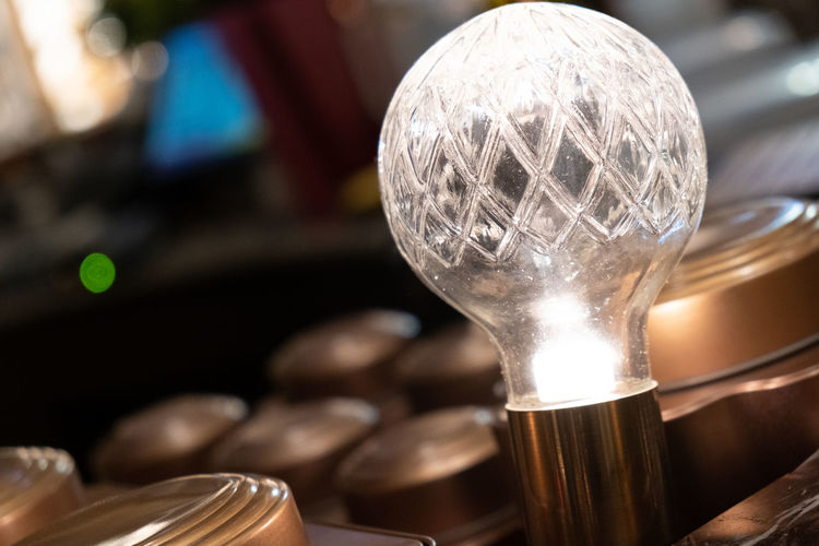 Close-up of light bulb on table