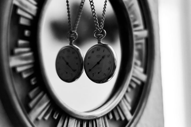 Close-up of pocket watches hanging at home
