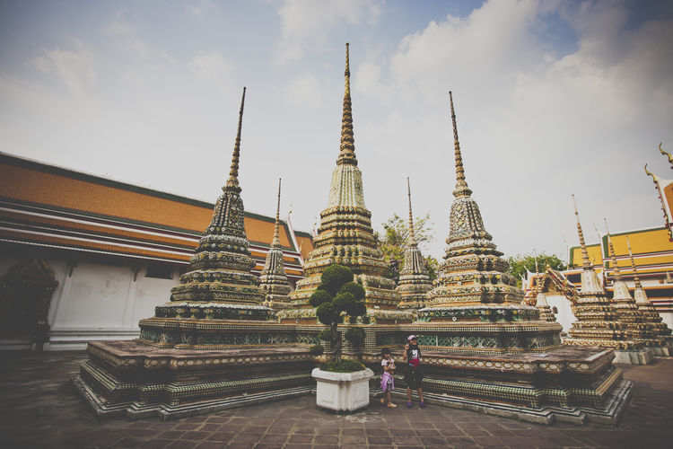 details of Wat Pho in Thailand Architectural Feature Architecture Asian Culture Buddha Buddhist Temple Building Exterior Built Structure Culture Cultures Day Gold Gold Colored Outdoors Pagoda Place Of Worship Religion Sky Spire  Spirituality Steeple Stupa Temple Temple - Building Travel Destinations