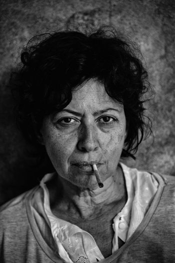 Close-Up Portrait Of Mature Woman Smoking Joint