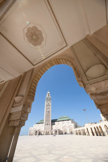 Low angle view of mosque against clear sky