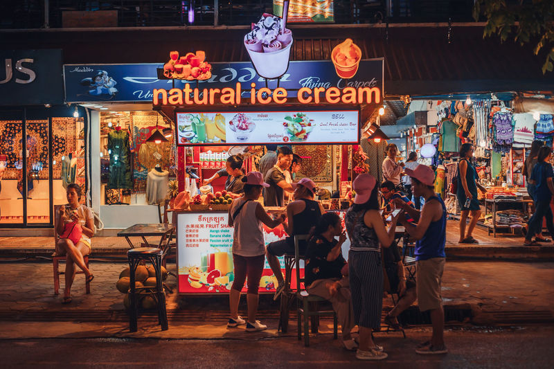 Ice cream anyone? Streetphotography Street Business Ice Cream People Nightlife Night Market Siem Reap Cambodia City Arts Culture And Entertainment Illuminated Full Length Business Finance And Industry Architecture Frozen Sweet Food Flavored Ice Ice Cream Parlor Frozen Food Summer In The City