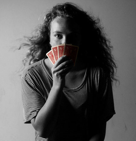 Bluff Cards Front View Gambling Girl Holding Lies Looking At Camera Person Poker Pokerface Portrait Portrait Of A Woman Red Shaded Shadow Studio Shot Twoface Woman Young Adult Young Women Showcase April