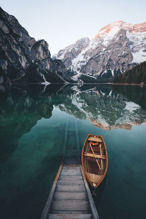 Who wants to take a seat in this boat? Beauty In Nature Boat Calm Day Dolomites, Italy EyeEm Best Shots Idyllic Lago Di Braies Lake Landscape Mountain The Great Outdoors - 2016 EyeEm Awards Nature No People Outdoors Remote Scenics Sky Snowcapped Mountain Sunrise The Way Forward Tranquil Scene Tranquility Travel Destinations VSCO