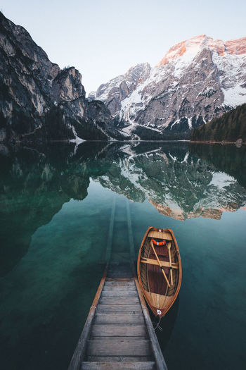 Boat Moored On Pragser Wildsee Lake Against Dolomites