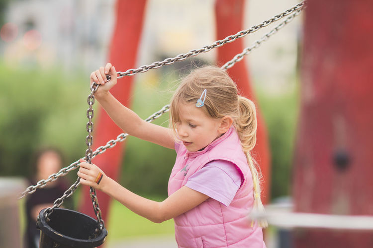 Girl holding bucket at playground