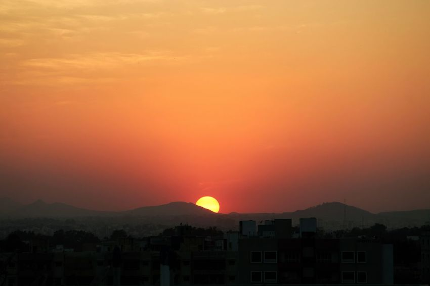 Sunset over City Astronomy Beauty In Nature Nature No People Orange Color Outdoors Silhouette Sky Sunset