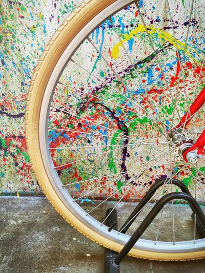 Close-up of bicycle parked against colorful wall