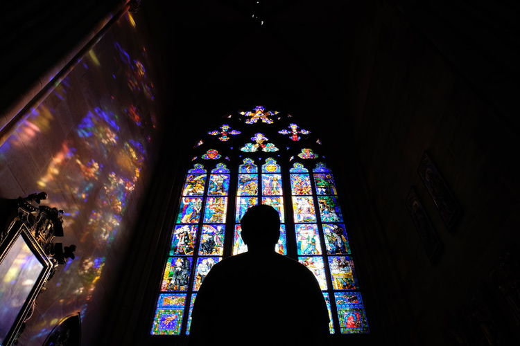 Stained Glass Indoors  Belief Window Religion Glass Place Of Worship Glass - Material Architecture Rear View Spirituality Building Multi Colored One Person Illuminated Low Angle View Standing Built Structure