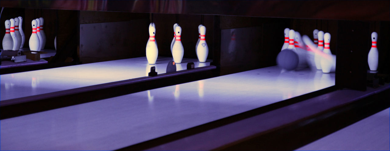 Available Light Bowling Bowling Shoes Competition Dynamic Illuminated Indoors  Low Light Ninepins No People Skittles Sport