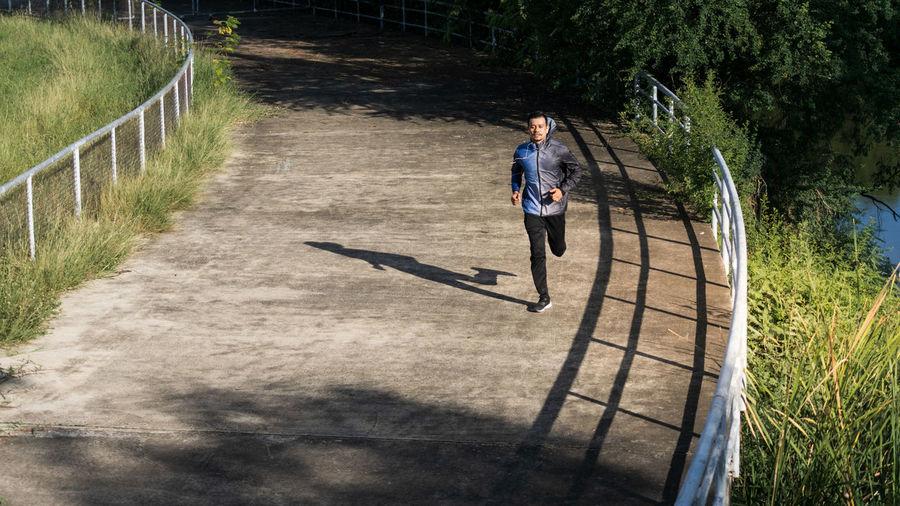 Full length of woman running on street