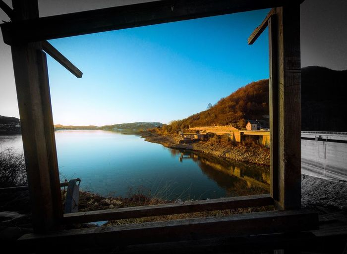 Scenic view of river seen through window