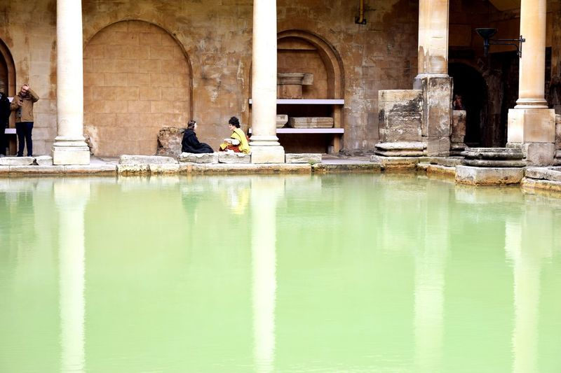 EyeEm Selects Traveling in Bath United Kingdom Roman Bath Roman Ruins Historical Building Travel Destinations Tourist Attraction  Arch Architecture Architectural Column Built Structure Water Reflection Day Building Exterior Outdoors Real People Animal Themes Mammal Travel Photography Green Water Reflection Reflections In The Water