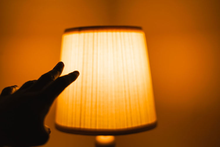 Light and Touch. Human Body Part Human Hand Hand Indoors  Illuminated One Person Lighting Equipment Body Part Close-up Finger Electric Lamp Human Finger Holding Unrecognizable Person Studio Shot Colored Background Silhouette Glowing Orange Color Human Limb The Week on EyeEm