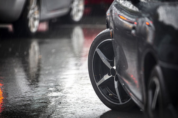 Car on wet road in rainy season