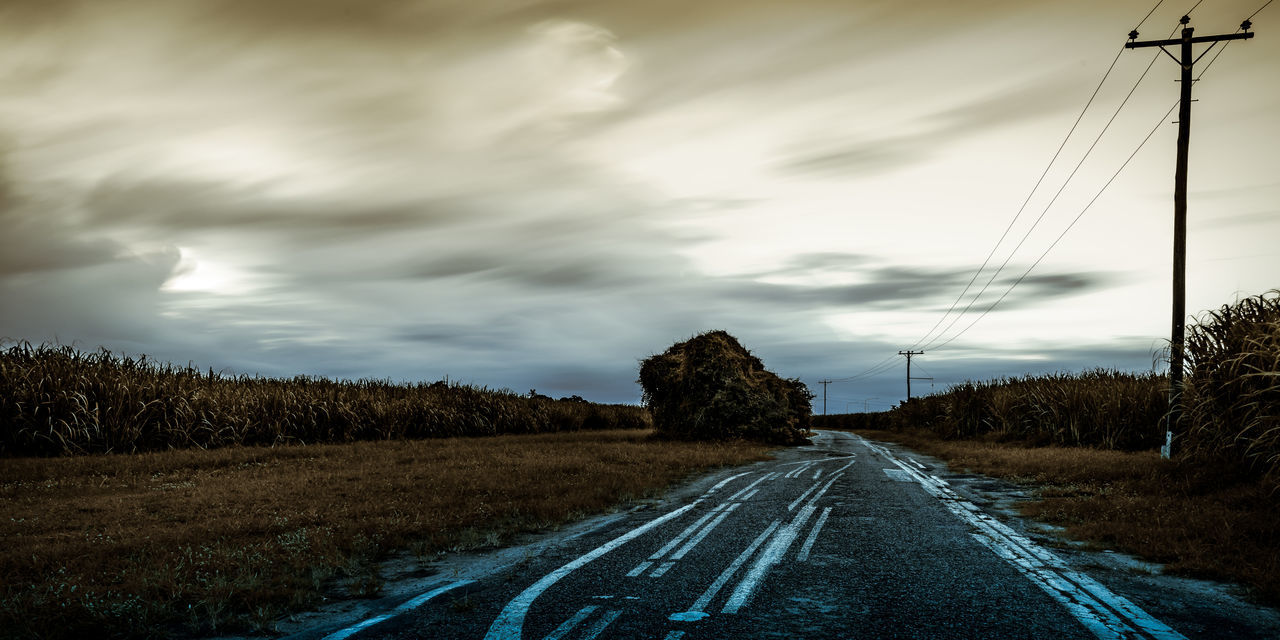 Road By Trees Against Sky