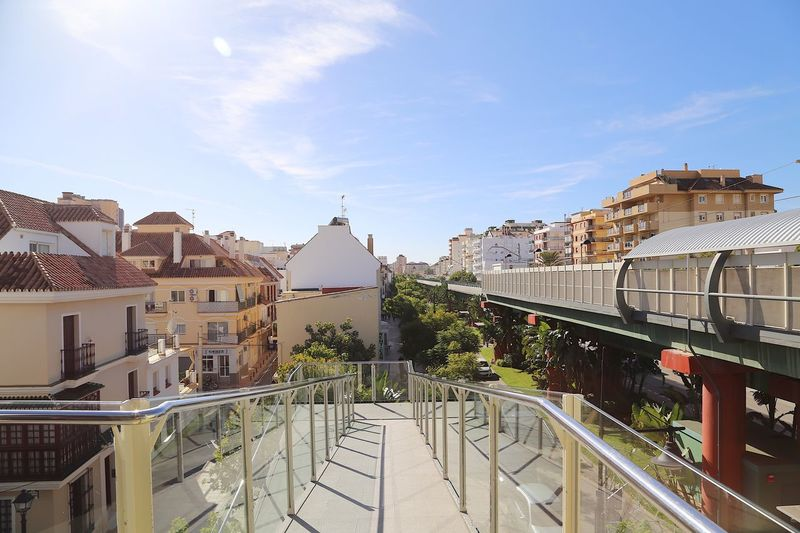 Train station Railings Railing Traintracks Train Station Train Los Boliches City View  Calm Scene SPAIN Andalucía Andalucia Spain Architecture Built Structure Building Exterior Sky City Cloud - Sky Building Residential District Sunlight Railing Nature Day No People Cityscape City Life Outdoors High Angle View Street