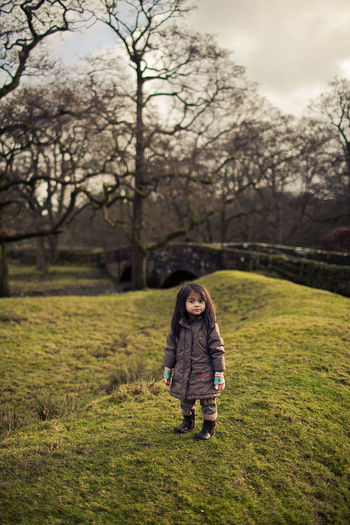 A girl in a forest near Abbeystead, Lancashire Bare Tree Beauty In Nature Field Full Length Grass Leisure Activity One Person Outdoors Portrait Standing Tree Investing In Quality Of Life Investing In Quality Of Life