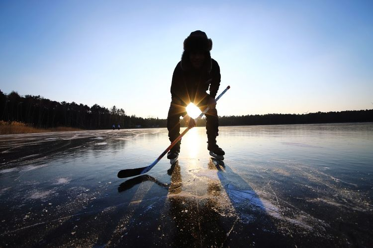 Silhouette Man Playing Ice Hockey