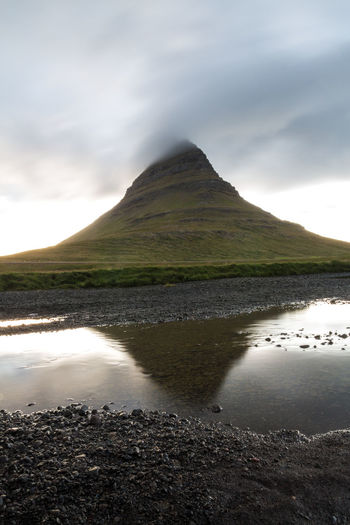 The most perfectly shaped mountain I know: Kirkjufell in Iceland! Captured on my summer vacation 2016 :) Beauty In Nature Canon_photos Day Green Grass Iceland Kirkjufell Kirkjufellsfoss Landscape Landscape Photography Long Exposure Mountain Nature Nature No People Outdoors Reflection Scenics Sky Travel Vacation Water Waterdrops Waterfall Weather Wilderness
