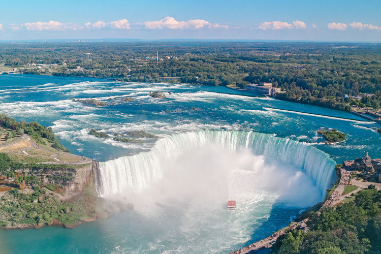 Aerial top landscape view of niagara falls between united states of america and canada. horseshoe