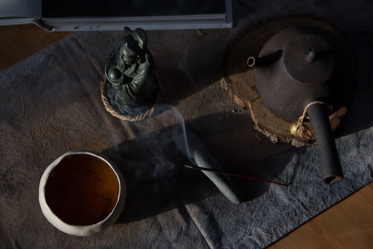 morning tea Morning Morning Light Ritual Bowl Cultures Cup Day Drink Food Food And Drink Harmony High Angle View Incense Incense Sticks Indoors  Key Mug No People Paper Refreshment Still Life Table Textile Water Wood - Material