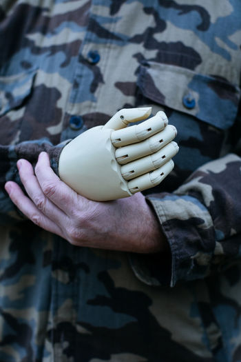 Midsection of soldier with prosthetic arm