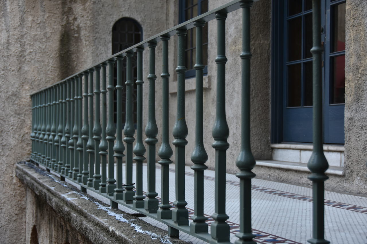 architecture, built structure, metal, railing, building exterior, outdoors, no people, day, prison