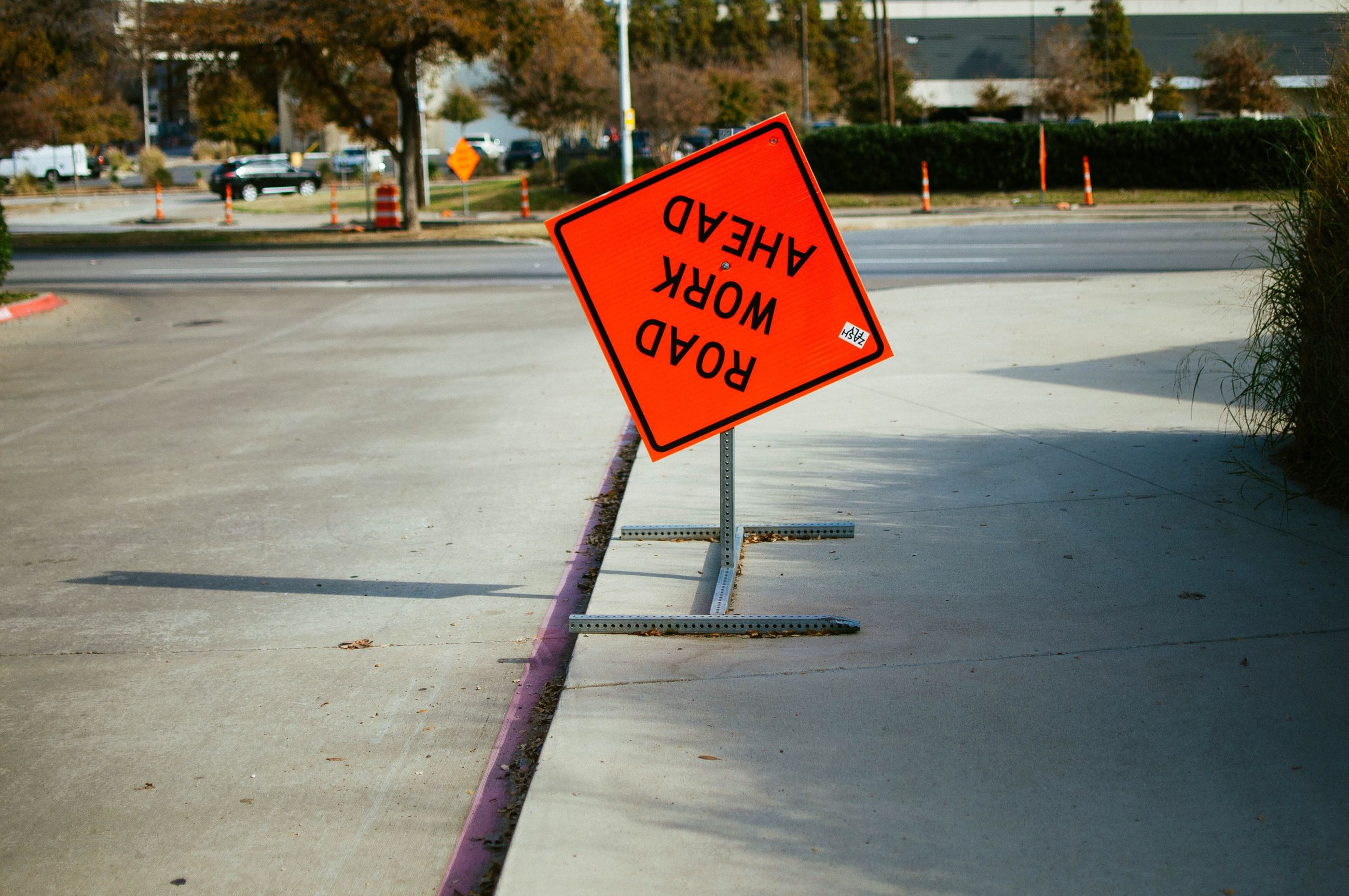 text, communication, guidance, road, warning sign, road sign, safety, outdoors, transportation, day, no people, traffic cone, close-up