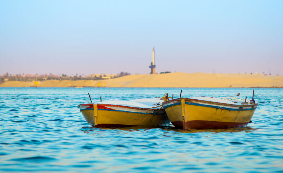 Twin boats Blue Boat Boats Day Nature Scenics Sea Sky Travel DestinationsSky And Sea Floating On Water Floating Side By Side Symetric Mirror Twins Water My Best Aqua Colors Sky Ismailia Lake Canal Egypt Traveling Home For The Holidays