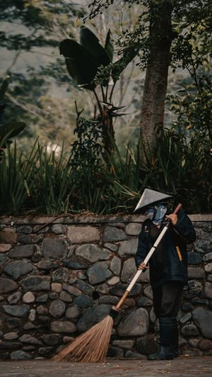 Man holding umbrella while standing on land