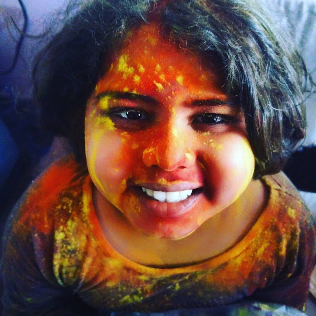 looking at camera, portrait, front view, one person, face paint, real people, headshot, holi, childhood, happiness, smiling, lifestyles, close-up, elementary age, powder paint, boys, outdoors, day, multi colored, halloween, one boy only, people