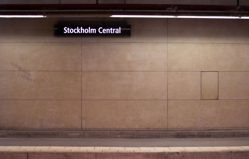 Information Sign On Wall At Illuminated Stockholm Central Station