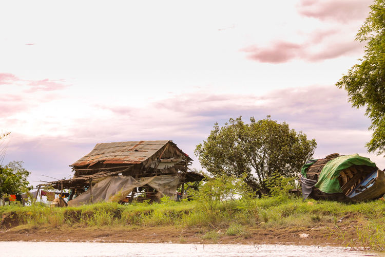 EyeEm Selects Real Life In Cambodia Architecture House Built Structure Tree Building Exterior Cloud - Sky No People Sky Outdoors Day Nature Fishing Village Cambodia House By The River ASIA Lifestyles Agriculture Battambang, Cambodia