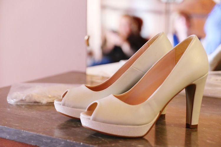 Close-Up Of High Heels On Table