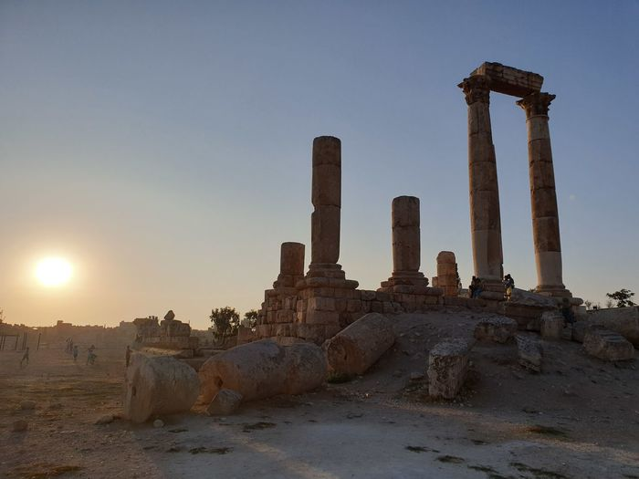 Old ruins of temple against sky during sunset