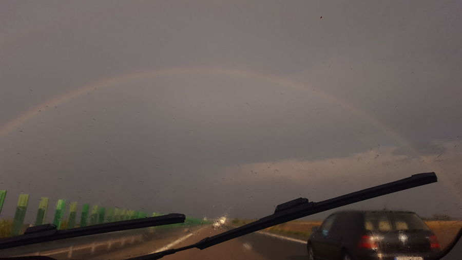 Beauty In Nature Car Drops Nature Outdoors Personal Perspective Rainbow Raindrops Sky The Drive Transportation Windshield Wipers Chance Encounters Finding New Frontiers Close Up Technology Uniqueness
