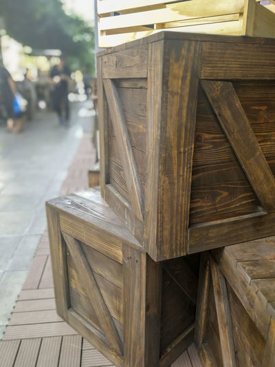 Advertising Box Building Exterior Close-up Communication Container Design Empty Façade Focus On Foreground Footpath Geometric Shapes Interior Design Interior Style Low Angle View Office Outdoors Selective Focus Square Street Style Urban Walkway Wood Wood - Material