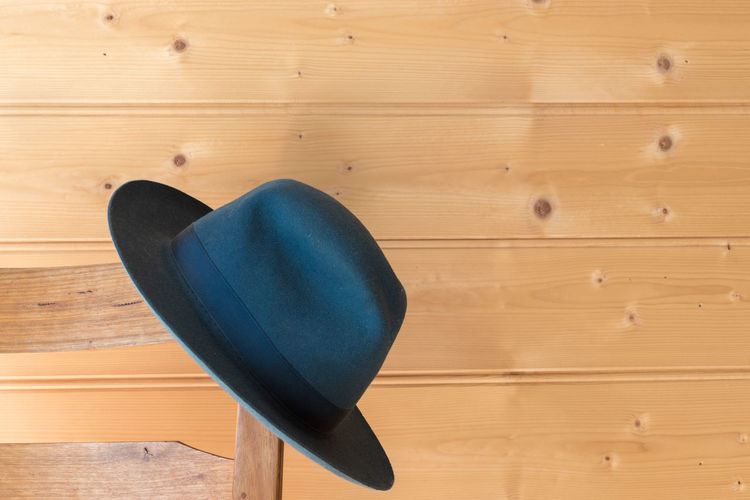 Blue hat and chair Hat Absence Blue Brown Close-up Empty Home Interior Indoors  No People Seat Single Object Still Life Wall - Building Feature Wood Wood - Material Wood Grain