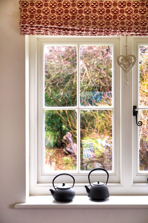 looking out on the colours of the winter garden Architecture Cosy Cottage Life Cottage Window Day EyeEm New Here Garden, Growth Home Interior Indoors  Interior Views Lounge Nature No People Plant Tree Warm Window Window Frame Window Light Window Reflections Window Sill Windows Wooden