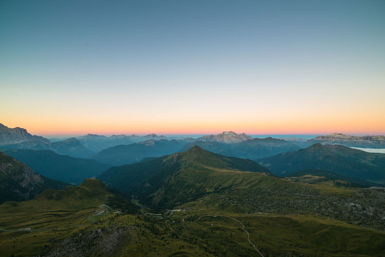 View from the Rifugio Averau towards the Passo Giau at the break of dawn Beauty In Nature Clear Sky Colorful Dolomites Dolomiti Idyllic Italy Landscape Majestic Mountain Mountain Range Nature No People Outdoors Scenics Serene Sunrise - Dawn Tourism Tranquility Travel Destinations