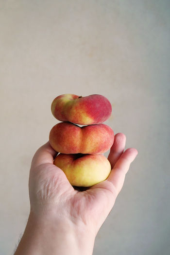 flat peaches Stack Donut Peaches Flat Peaches Food Food And Drink Fruit Hand Healthy Eating Holding Human Hand Indoors  Peach Peaches Personal Perspective Pile Saturn Peaches Stacked Unrecognizable Person