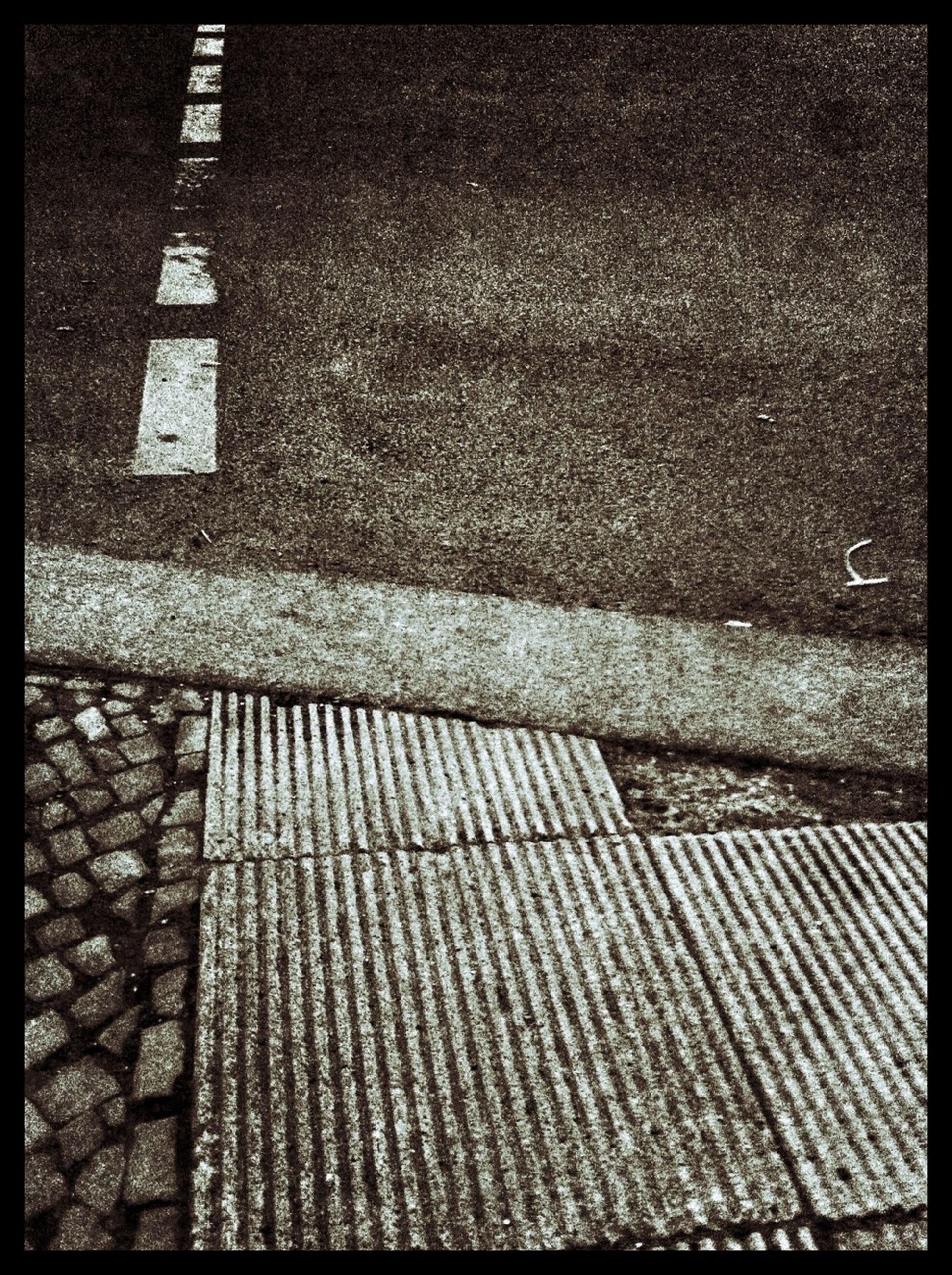 transfer print, auto post production filter, high angle view, cobblestone, pattern, textured, wall - building feature, paving stone, sidewalk, steps, architecture, sunlight, street, no people, built structure, day, shadow, outdoors, wall, road marking