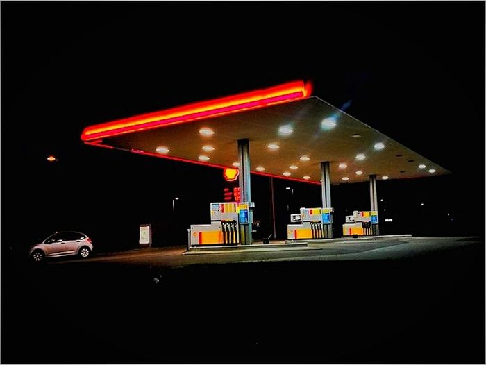 Fuel Pump Gasoline Refueling Fossil Fuel Gas Station Fuel And Power Generation Illuminated Transportation Night Car Oil Industry No People Neon Land Vehicle Built Structure Outdoors Industry Oil Pump The Traveler - 2018 EyeEm Awards
