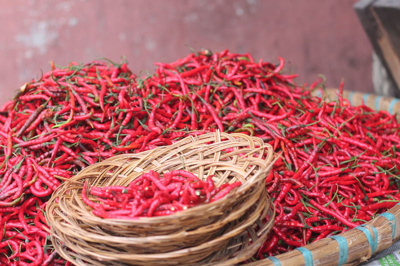 Extreme close up of red chilies against the wall