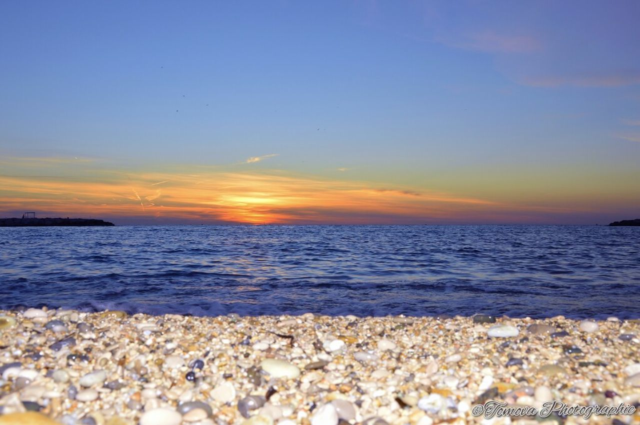 sea, sunset, beauty in nature, nature, scenics, water, beach, tranquility, wave, tranquil scene, outdoors, no people, horizon over water, sky, pebble beach, day