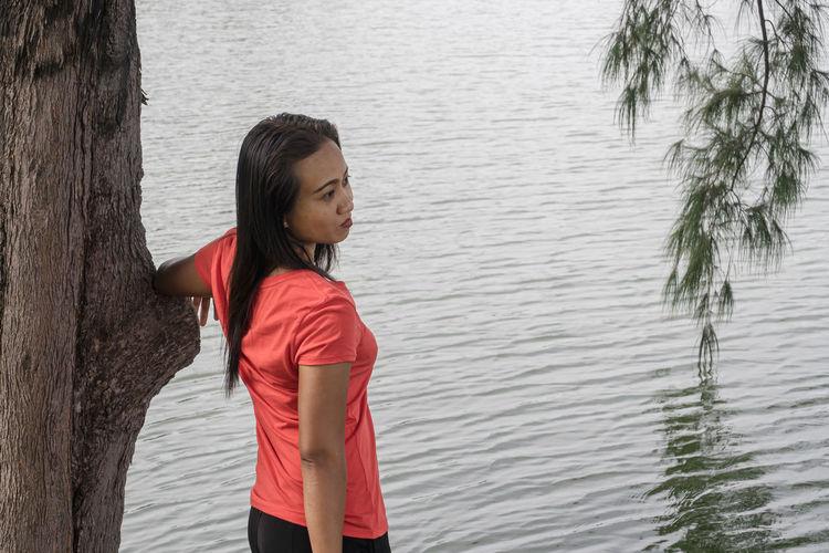 Young woman looking at lake